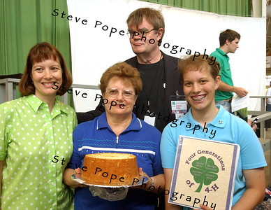 "Gary Edward ""Garrison"" Keillor ,is an American author, storyteller, humorist, and radio personality and best known as the host of the Minnesota Public Radio show A Prairie Home Companion, takes time out for a photo with Four Generations of 4-H family members, at the 2008 Iowa State Fair."