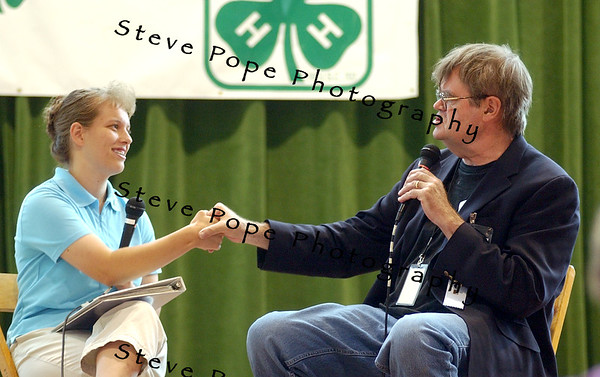"Gary Edward ""Garrison"" Keillor ,is an American author, storyteller, humorist, and radio personality and best known as the host of the Minnesota Public Radio show A Prairie Home Companion, thanks a 4-H members after an interview on stage at the 4-H building, at the 2008 Iowa State Fair."