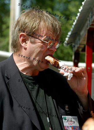 "Gary Edward ""Garrison"" Keillor ,is an American author, storyteller, humorist, and radio personality and best known as the host of the Minnesota Public Radio show A Prairie Home Companion, eats a Pork Chop on a Stick, at the 2008 Iowa State Fair"