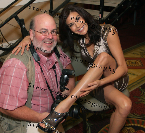 Desperate Housewives star Teri Hatcher at the Principal Charity Classic Draw party shows photographer Steve Pope her million dollar legs and her priceless shoes.