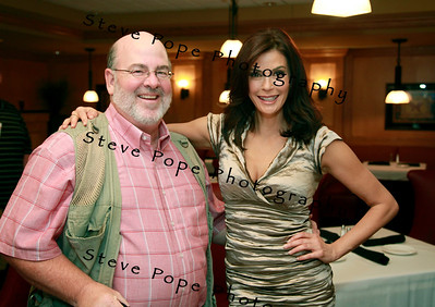 Desperate Housewives star Teri Hatcher at the Principal Charity Classic Draw party and photographer Steve Pope mug for a quick photo before the event.
