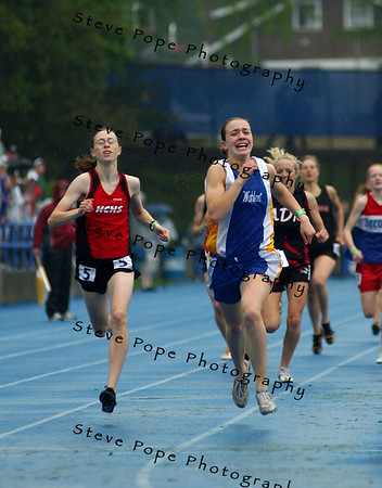 Dubuque Wahlert's Mary Bridget Corken edges out Harlan's Regina Reinig by .12 in the Class 3A 800 run at the state track meet, Saturday May 21, 2005 in Des Moines, Iowa. (AP Photo/Steve Pope)