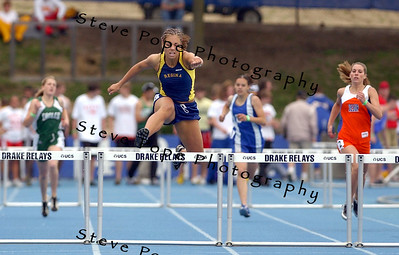 Iowa City Regina's Carly DuCharme runs in and wins the Class 2A 400 hurdles at the state track meet, Friday May 20, 2005 in Des Moines, Iowa. (AP Photo/Steve Pope)