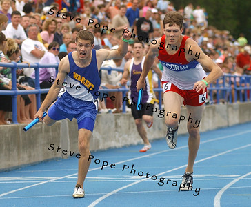 Dubuque Wahlert's Adam Kramer, left, and Decorah's James Ruen are neck and neck at the finsih of the Class 3A 2x400 at the state track meet, Friday May 20, 2005 in Des Moines, Iowa. Wahlert edged out Decorah by .02 of a second for first place. (AP Photo/Steve Pope)
