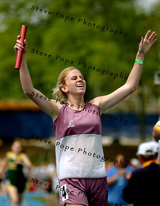 North Linn's Ellen Ries celebrate her team's victory in the Class 1A Distance Medley at the state track meet, Saturday May 21, 2005 in Des Moines, Iowa. Ries's state meet career ended with her 13th victory in 13 events. (AP Photo/Steve Pope)