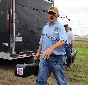 Mike Stricker being a roadie in a few random scenes from the 2010 Mitchell County Fair, in Osage, Iowa.
