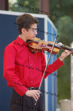 """Nathanael Hardy, 13, of Prole, IA performs """"Gypsy Airs"""" during the Bill Riley Talent Search on the Anne and Bill Riley Stage at the 2007 Iowa State Fair on Friday, August 10, in Des Moines, IA.  (Iowa State Fair Photo)"""