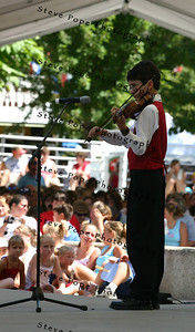 Nathaniel Hardy, 11, of Prole, Iowa, plays his violin in the Bill Riley Talent Search on the Riley Stage at the 2005 Iowa State Fair on Saturday, August 20, in Des Moines, Iowa.