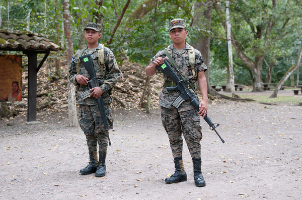 Guards at the Mayan ruins of Copan.  Don't even think of walking off with stuff.