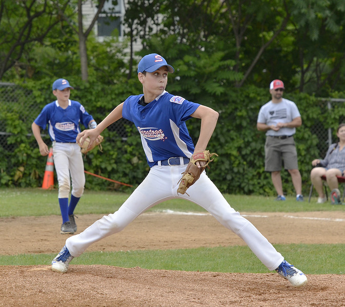 STAN HUDY - SHUDY@DIGITALFIRSTMEDIA.COM<br /> Saratoga Springs Stars starter Evan Ash fires towards the plate against  Marcy Deerfield in Saturday's sectional opener at West Side Rec.