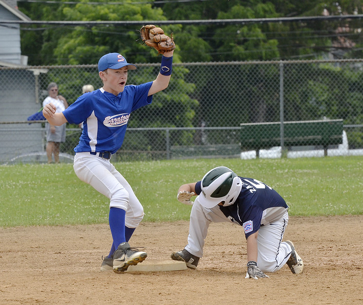 STAN HUDY - SHUDY@DIGITALFIRSTMEDIA.COM<br /> Saratoga Springs Stars shortstop Orion Lansing reacts to the safe call during a steal of second by Marcy Deerfield's Vinny Zajac late in Saturday's sectional opener at West Side Rec.