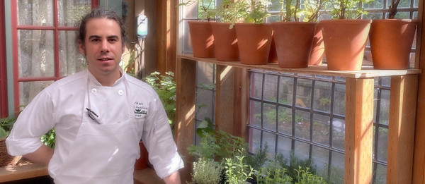 Herbfarm Chef Chris Weber in the Kitchen Greenhouse at the restaurant.