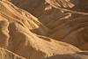 Golden-brown mudstone hills at Zabriskie Point