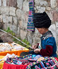 Miao (a minority ethnic group) woman selling handcrafts