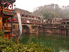 Along the Tuo Jiang River.  Stilts are used to raise the houses above water.