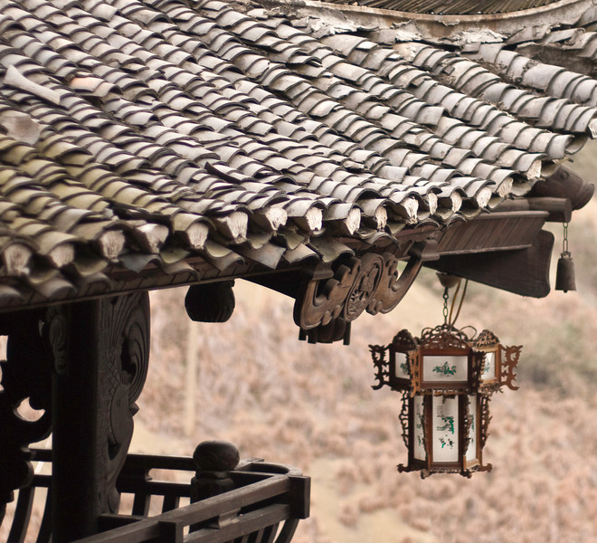 Lantern hanging from the roof of a Tujia's building.  <br /> There are 56 ethnic groups in China and Tujia is the 6th largest group.