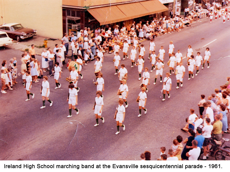 A photo of the Ireland High School marching band in the Evansville sequicentennial parade in 1961.  (I added the text at the bottom of the photo.).  Anyone want to identify the people in the photo?  I can help with the trumpets in the 4th row; Left to right, Sylvia Bickwermert, LaVerne Keusch, unknown, Rich Brown, Sam Voelkel (me).