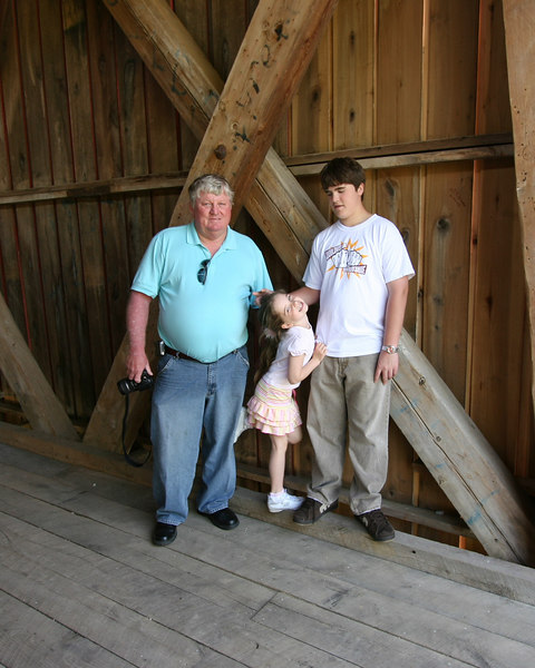 Doug, Emma, and Lincoln pause at the entrance to the covered bridge at Cataract Falls.