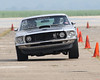 Bret Voelkel's Mustang lifts it's left front wheel due to abundant engine torque as he manuevers through the slalom section of the autocross competition at the Mid-America Air Center at Lawrenceville, Illinois.