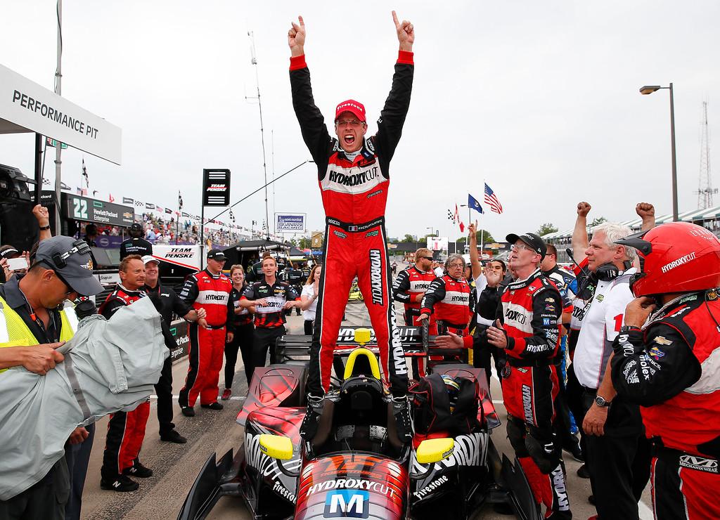 . Sebastien Bourdais, of France, celebrates winning race one of the IndyCar Detroit Grand Prix auto racing double header on Belle Isle in Detroit, Saturday, June 4, 2016. (AP Photo/Paul Sancya)