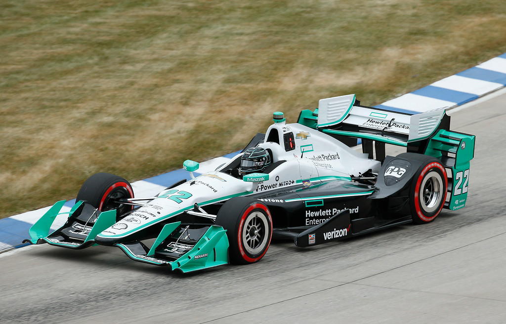 . Pole sitter Simon Pagenaud races during race one of the IndyCar Detroit Grand Prix auto racing doubleheader on Belle Isle in Detroit, Saturday, June 4, 2016. (AP Photo/Paul Sancya)