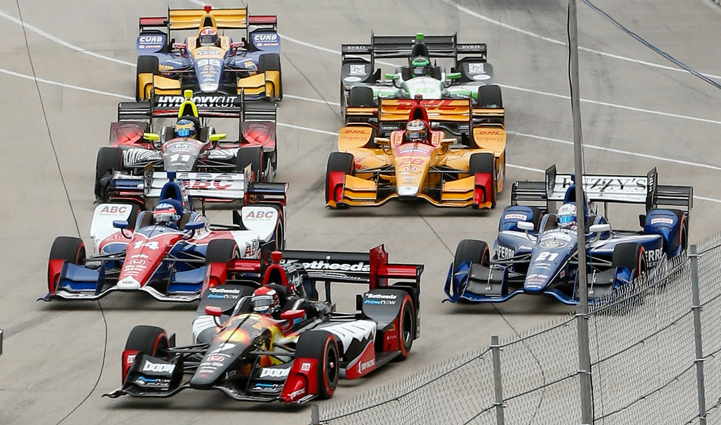 . Cars make a turn during race one of the IndyCar Detroit Grand Prix auto racing double header on Belle Isle in Detroit, Saturday, June 4, 2016. (AP Photo/Paul Sancya)