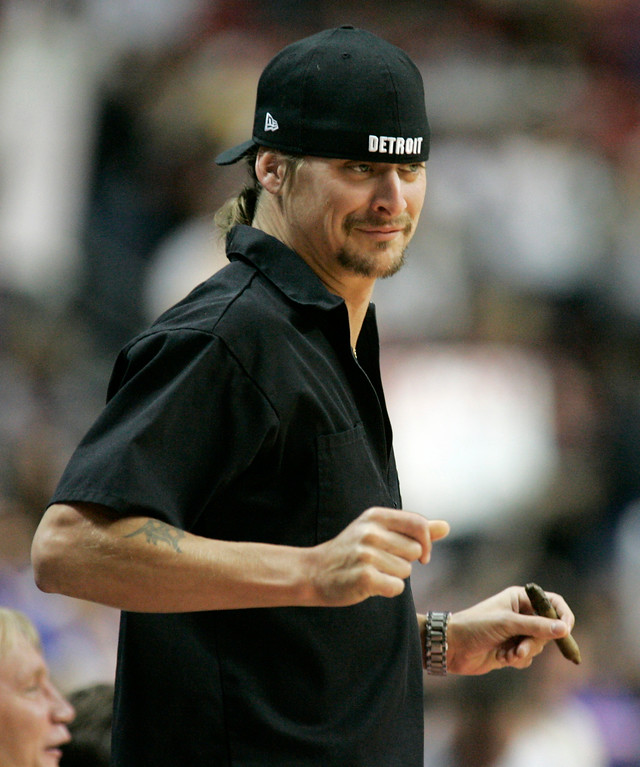. Musician Kid Rock does a little dance during the fourth quarter of the Detroit Pistons\' 79-61 win over the Cleveland Cavaliers in Game 7 of the NBA basketball playoffs at the Palace in Auburn Hills, Mich., Sunday, May 21, 2006. The Pistons will take on the Miami Heat starting Tuesday in the Eastern Conference finals. (AP Photo/Duane Burleson)