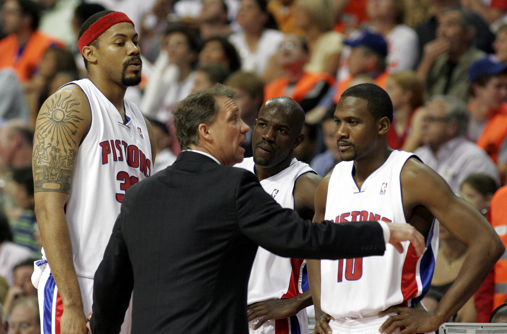 . Detroit Pistons, from left, forward Rasheed Wallace and guards Tony Delk and Lindsey Hunter, listen to coach Flip Saunders during a timeout in the second quarter of Game 1 of the Eastern Conference NBA basketball playoffs second-round series at the Palace in Auburn Hills, Mich., Sunday, May 7, 2006. (AP Photo/Duane Burleson)