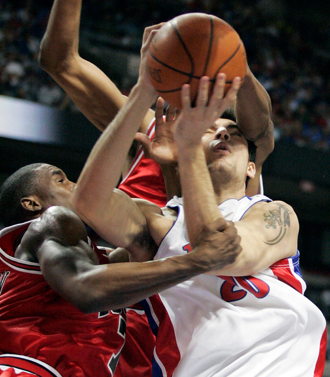 . Detroit Pistons guard Carlos Delfino, of Argentina, is fouled by Chicago Bulls guard Ben Gordon, left, while going for a layup in the fourth quarter of Game 2 of an NBA second-round playoff basketball series Monday, May 7, 2007, in Auburn Hills, Mich. The Pistons beat the Bulls 108-87 to take a 2-0 lead in the best-of-seven series. (AP Photo/Duane Burleson)