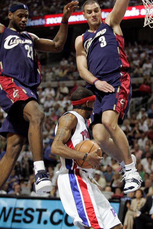. Cleveland Cavaliers forward LeBron James (23) and guard Sasha Pavlovic of Serbia & Montenegro, defend Detroit Pistons guard Richard Hamilton during the first quarter of an NBA Eastern Conference final basketball game at the Palace of Auburn Hills, Mich., Thursday, May 24, 2007. (AP Photo/Duane Burleson)