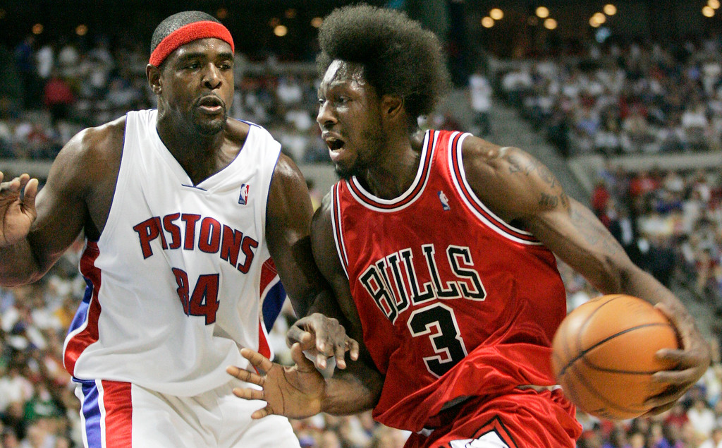 . Chicago Bulls center Ben Wallace, right, drives against Detroit Pistons center Chris Webber, during the first half of Game 5 of an NBA second-round playoff basketball series, Tuesday, May 15, 2007, in Auburn Hills, Mich. (AP Photo/Duane Burleson)