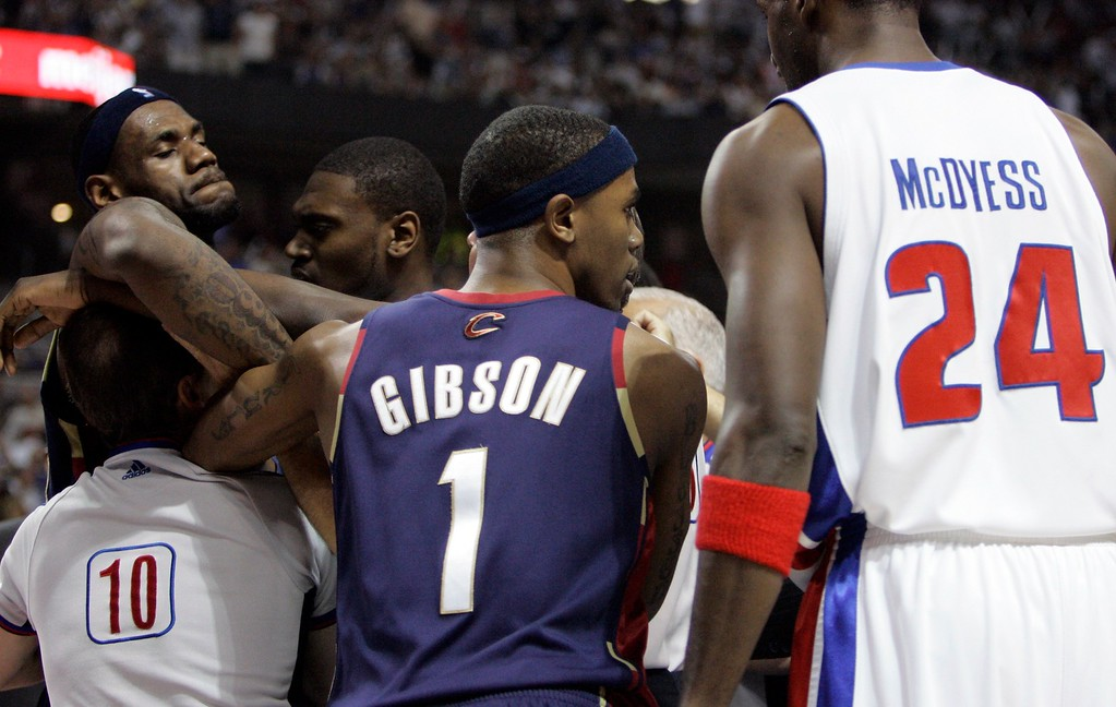 . Cleveland Cavaliers forward LeBron James, left, is held back after he rushed the court in protest of Detroit Pistons forward Antonio McDyess\' foul on Cavaliers center Anderson Varejao during the first quarter of an NBA Eastern Conference final basketball game at the Palace of Auburn Hills, Mich., Thursday, May 31, 2007. McDyess was ejected for the foul.  (AP Photo/Paul Sancya)