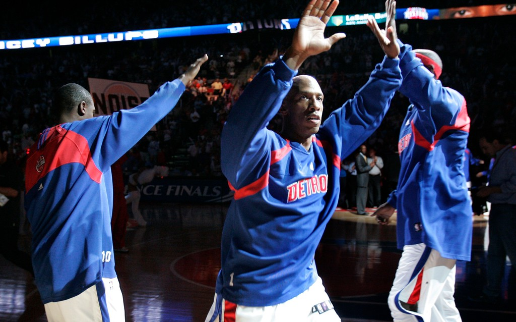 . Detroit Pistons guard Chauncey Billups, center, greets teammates Lindsey Hunter, left, and center Chris Webber during player introductions before the start of Game 2 of an NBA Eastern Conference final playoff basketball game at the Palace of Auburn Hills, Mich., Thursday, May 24, 2007. (AP Photo/Duane Burleson)
