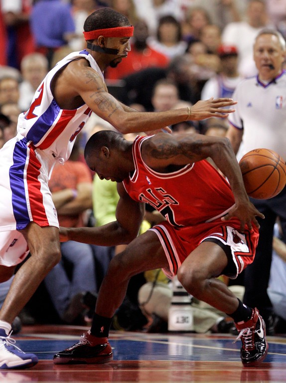 . Chicago Bulls guard Ben Gordon (7) loses control of the ball after running into Detroit Pistons guard Richard Hamilton (32) during the first quarter of an Eastern Conference semifinal NBA playoff basketball game in Auburn Hills, Mich., Tuesday, May 15, 2007. (AP Photo/Carlos Osorio)