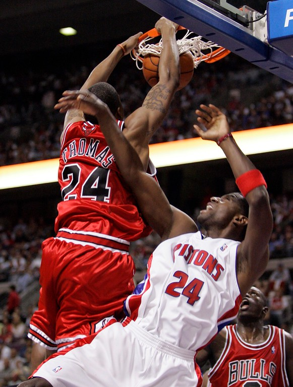 . Chicago Bulls forward Tyrus Thomas (24) dunks over Detroit Pistons forward Antonio McDyess (24) during the third quarter of an Eastern Conference semifinal NBA playoff basketball game at the Palace of Auburn Hills, Mich., Tuesday, May 15, 2007. The Bulls won 108-92.(AP Photo/Carlos Osorio)