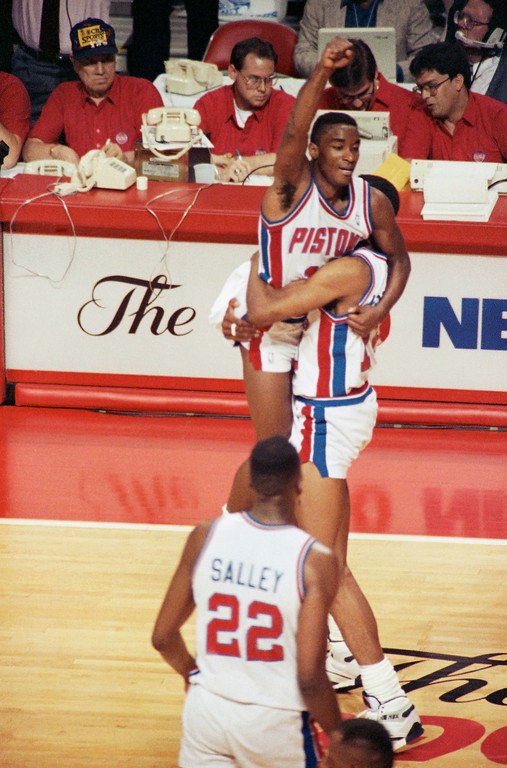 . Detroit?s Isiah Thomas is hoisted aloft by teammate Dennis Rodman in the closing minutes of Game 1 with the Portland Trail Blazers in the NBA Finals at the Palace in Auburn Hills, Mich. on Tuesday, June 5, 1990. The Pistons beat the Blazers 105-99. (AP Photo/Elisa Amendola)