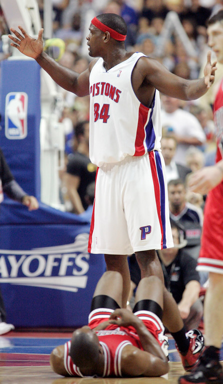 . Detroit Pistons center Chris Webber reacts after being whistled for a foul on Chicago Bulls guard Ben Gordon, on court, in the third quarter of Game 5 of an NBA second-round playoff basketball series Tuesday, May 15, 2007, in Auburn Hills, Mich. Gordon scored 28 points in the Bulls 108-92 win, forcing Game 6 in the best-of-seven series. The Pistons lead the series 3-2. (AP Photo/Duane Burleson)