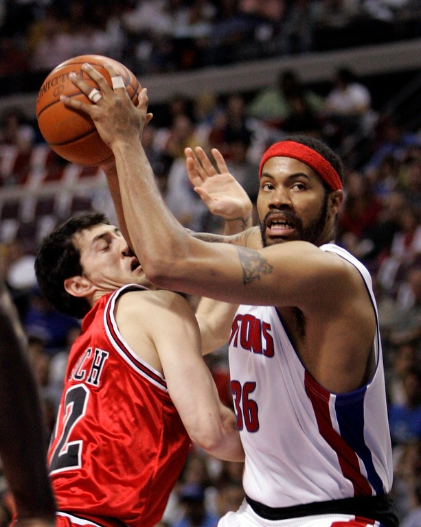 . Chicago Bulls guard Kirk Hinrich (12) is on the receiving end of Detroit Pistons foward Rasheed Wallace\'s elbow during the first quarter of an NBA Eastern Conference semifinal playoff basketball game at the Palace of Auburn Hills, Mich., Tuesday, May 15, 2007. (AP Photo/Carlos Osorio)