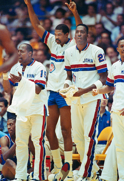 . Detroit Pistons Vinnie Johnson, left, James Edwards, center, and Michael Williams celebrate in the closing second of the Pistons NBA Championship win over the Los Angeles Lakers, Tuesday, June 13, 1989. (AP Photo/Bob Galbraith)