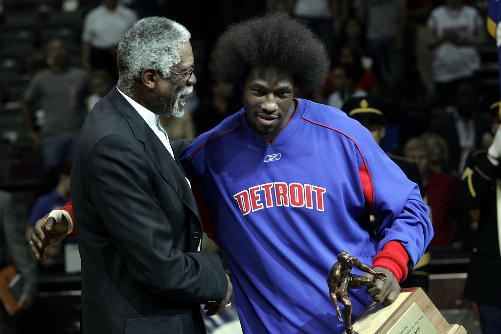 . Detroit Pistons center Ben Wallace is congratulated by Basketball Hall of Famer Bill Russell, left, after Wallace was presented the 2005-06 NBA Defensive Player of the Year Award before the start of Game 2 of the Pistons\' NBA basketball playoff series against the Cleveland Cavaliers at the Palace in Auburn Hills, Mich., Tuesday, May 9, 2006.  (AP Photo/Paul Sancya)
