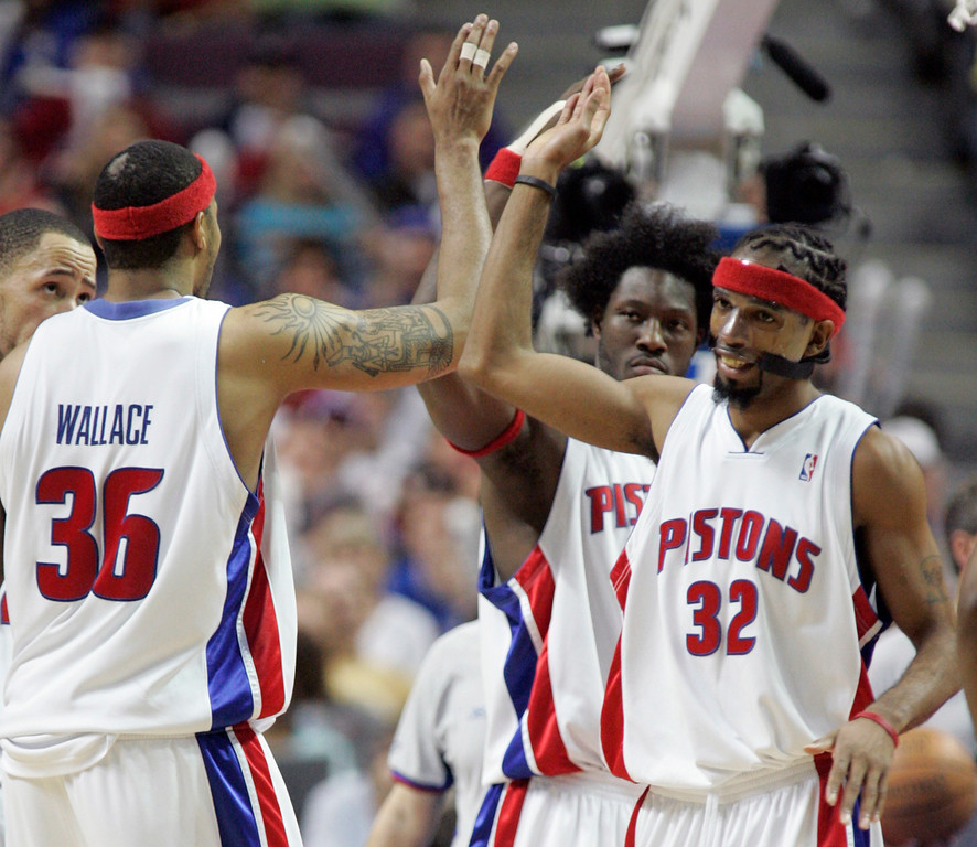. Detroit Pistons\' Richard Hamilton (32), Ben Wallace and Rasheed Wallace (36) celebrate in the fourth quarter of their 79-61 win over the Cleveland Cavaliers in Game 7 of the NBA basketball playoffs at the Palace in Auburn Hills, Mich., Sunday, May 21, 2006. The Pistons will take on the Miami Heat beginning Tuesday in the Eastern Conference finals. (AP Photo/Duane Burleson)