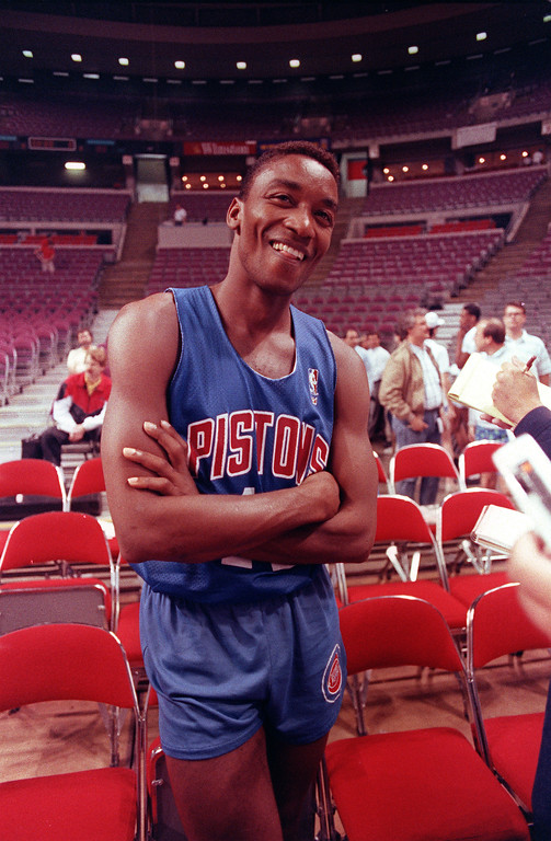 . Isiah Thomas, of the Detroit Pistons, jokes with reporters before practice at the Palace in Auburn Hills, Mich., Wednesday, June 6, 1990.  Thomas lead the Pistons with 33 points in their 105-99 win over the Portland Trail Blazers in game one of the NBA finals Tuesday night.  (AP Photo/Amy Sancetta)