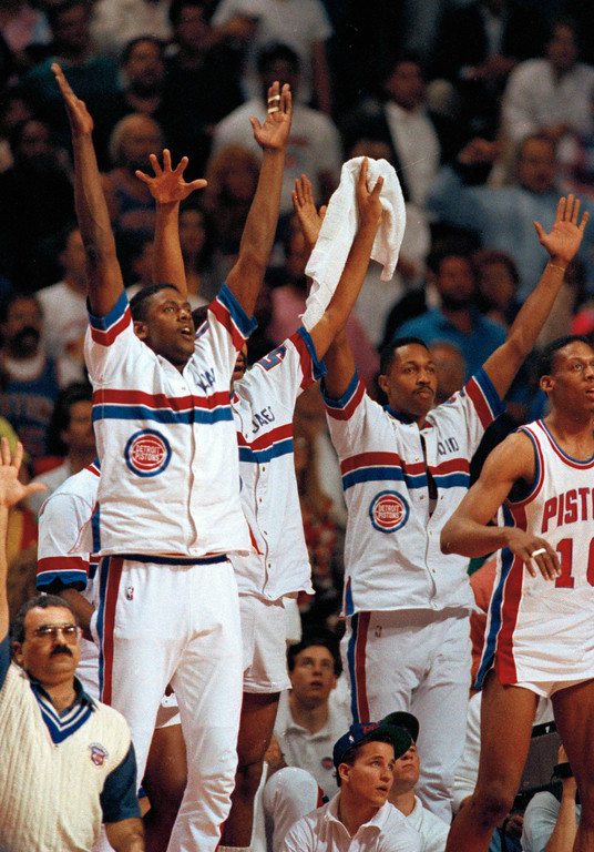 . The Detroit Pistons\' bench, William Bedford, left, James Edwards, David Greenwood and Dennis Rodman (10) celebrate in the closing minutes of Game 1 in the NBA Finals against the Portland Trail Blazers at the Palace in Auburn Hills, Mich., June 6, 1990.  (AP Photo/Lennox McLendon)