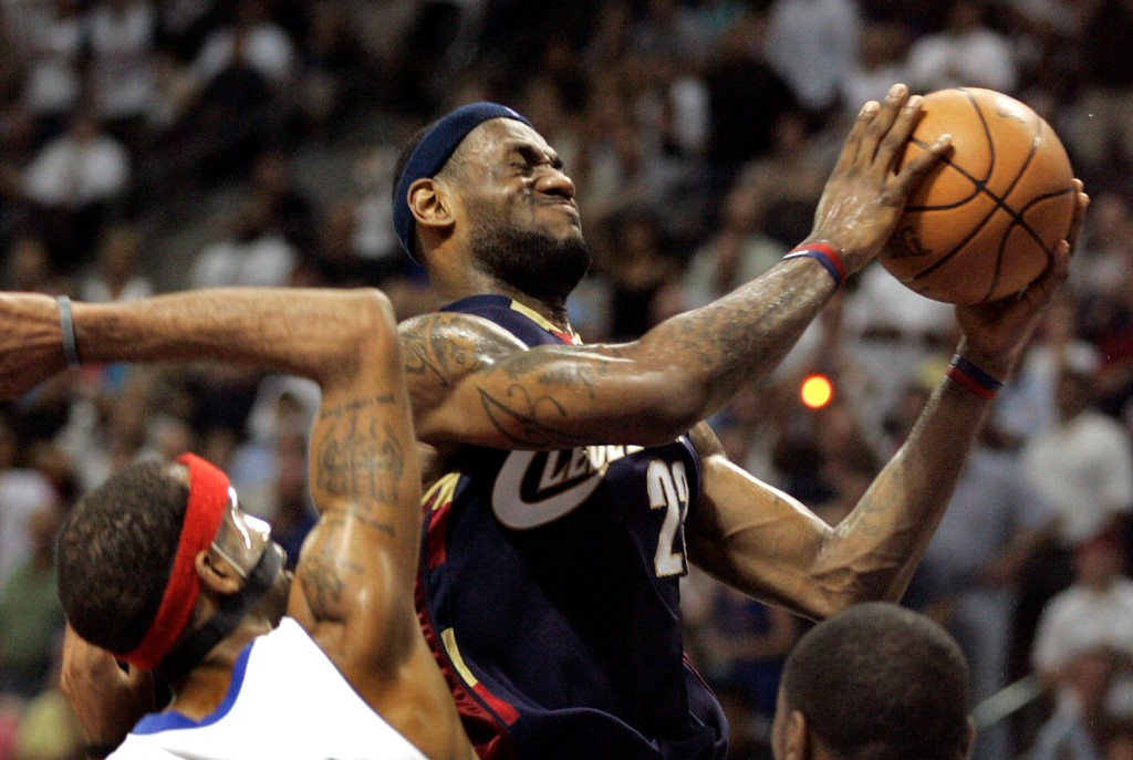 . Cleveland Cavaliers forward LeBron James makes a layup defended by Detroit Pistons guard Richard Hamilton during the fourth quarter of an NBA Eastern Conference final basketball game at the Palace of Auburn Hills, Mich., Thursday, May 31, 2007. (AP Photo/Duane Burleson)