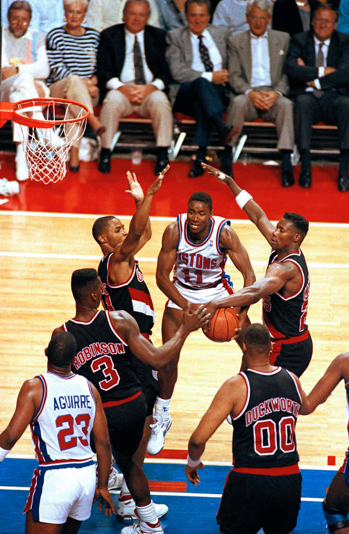 . Detroit\'s Isiah Thomas (11) gets caught between Portland\'s Danny Young,left, Cliff Robinson, Kevin Duckworth and Jerome Kersey, right, during the fourth quarter of Game 1 in the NBA Finals in Auburn Hills, Mich., June 6, 1990.  (AP Photo/Amy Sancetta)
