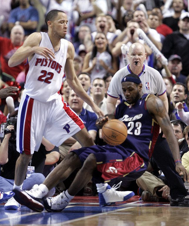 . Detroit Pistons forward Tayshaun Prince, left, looks on as Cleveland Cavaliers forward LeBron James stumbles and loses control of the ball during the fourth quarter in Game 7 of their NBA basketball playoff series at the Palace in Auburn Hills, Mich., Sunday, May 21, 2006. (AP Photo/Paul Sancya)
