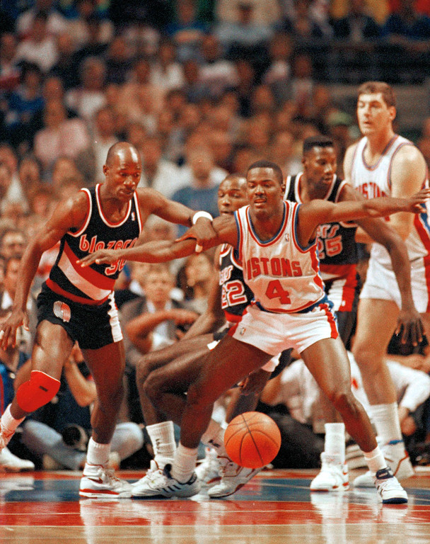 . Detroit Pistons\' Joe Dumars (4) tries to keep Portland\'s Terry Porter, left, away from the ball during the first quarter of Game 1 in the NBA finals at the Palace in Auburn Hills, Mich., June 5, 1990.  (AP Photo/Lennox McLendon)