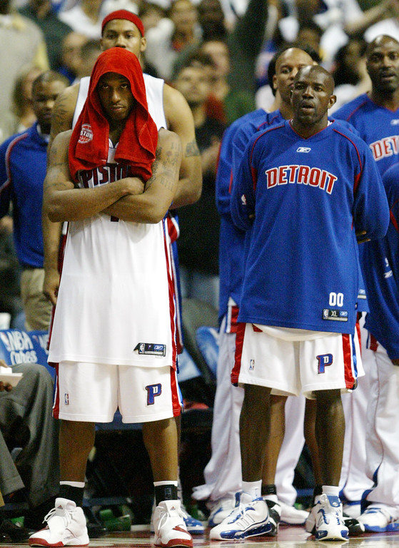 . Detroit Pistons from left, Chauncey Billups and Tony Delk watch from the sidelines in the closing seconds of their 86-84 loss to the Cleveland Cavaliers in the fourth quarter in game 5 of the NBA playoffs at the Palace in Auburn Hills, Mich., Wednesday, May 17, 2006.   (AP Photo/Paul Sancya)