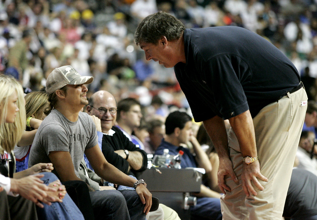 . Detroit Shock head coach and former Detroit Pistons player Bill Laimbeer, right, meets with musician Kid Rock, whose real name is Bob Ritchie, during the third quarter in Game 2 of the NBA basketball playoffs between the Pistons and the Cleveland Cavaliers at the Palace in Auburn Hills, Mich., Tuesday, May 9, 2006. (AP Photo/Duane Burleson)