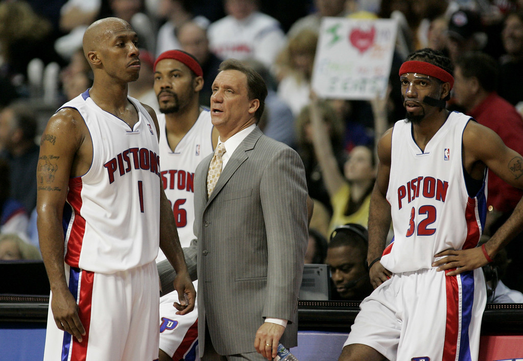 . Detroit Pistons head coach Flip Saunders, center, talks with guard Chauncey Billups (1) as teammates Rasheed Wallace, rear, and guard Richard Hamilton, (32) look on during a timeout in the second quarter of Game 7 of the NBA basketball playoffs against the Cleveland Cavaliers at the Palace in Auburn Hills, Mich., Sunday, May 21, 2006.  (AP Photo/Duane Burleson)